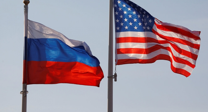 Tensions remain even as US returns Russian flags taken from diplomatic property