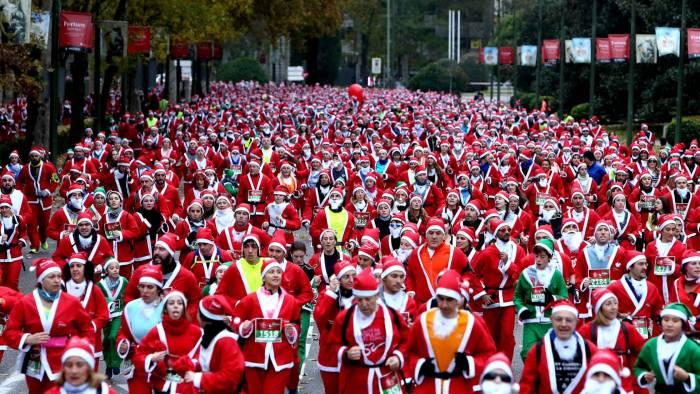 La carrera de Papá Noel en Madrid, en imágenes