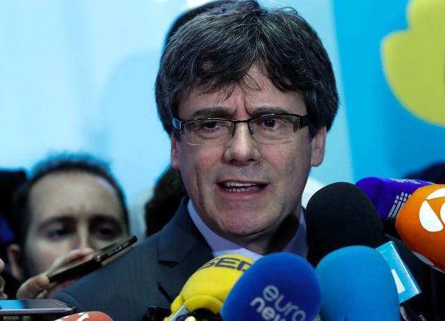 Carles Puigdemont hands himself into Belgian authorities