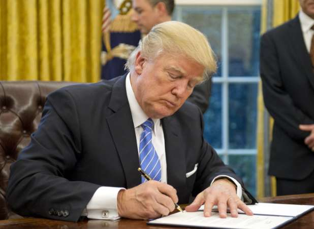 Trump signs bill extending trade embargo against Cuba for 1 year