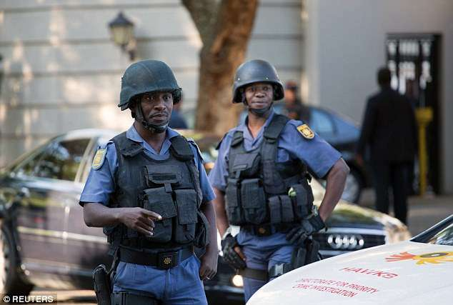 South African police raid business family linked to Zuma