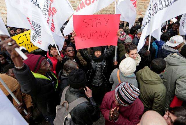 Italians march against racism after shooting spree against migrants