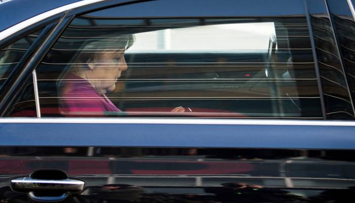 Angela Merkel reaches deal to form coalition government in Germany