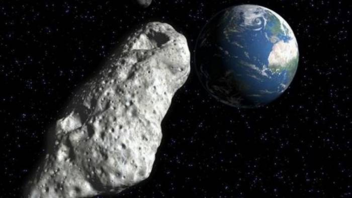 Asteroid skimming past Earth may loom larger than exploding Russian meteor