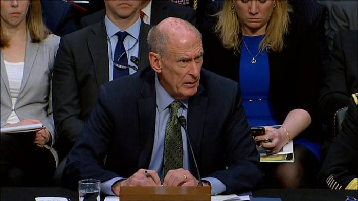Spy chief warns on Trump aides