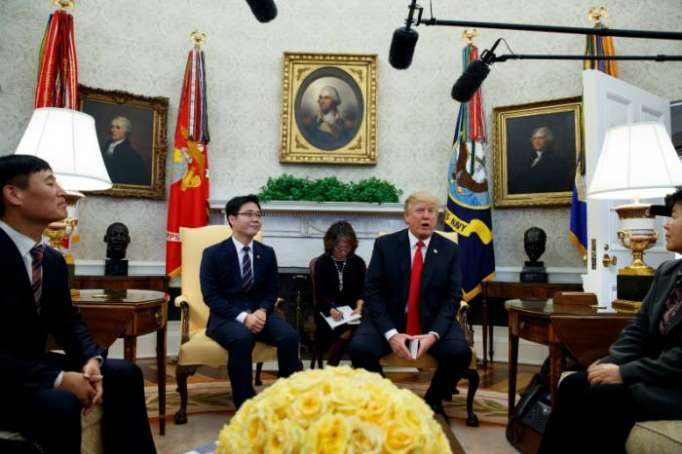 Trump meets with North Korean defectors in Oval Office in bid to raise pressure on Kim Jong Un