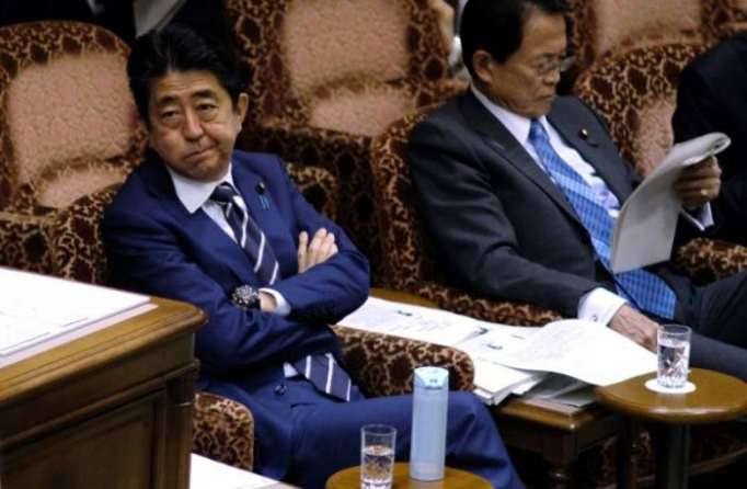 Japan minister says files altered in scandal dogging Abe