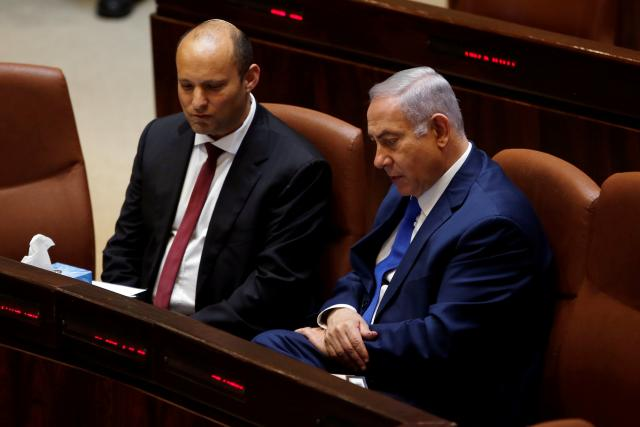 Israeli government ends feud that sparked snap election talk