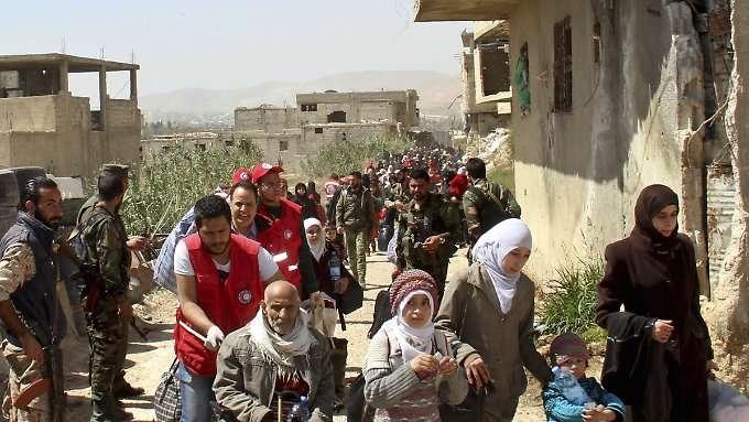 Assad verbaut Millionen die Rückkehr