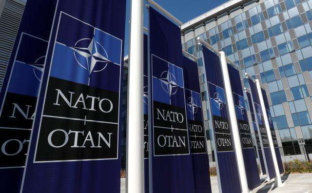 New home, but same worries, as NATO moves into glass and steel HQ