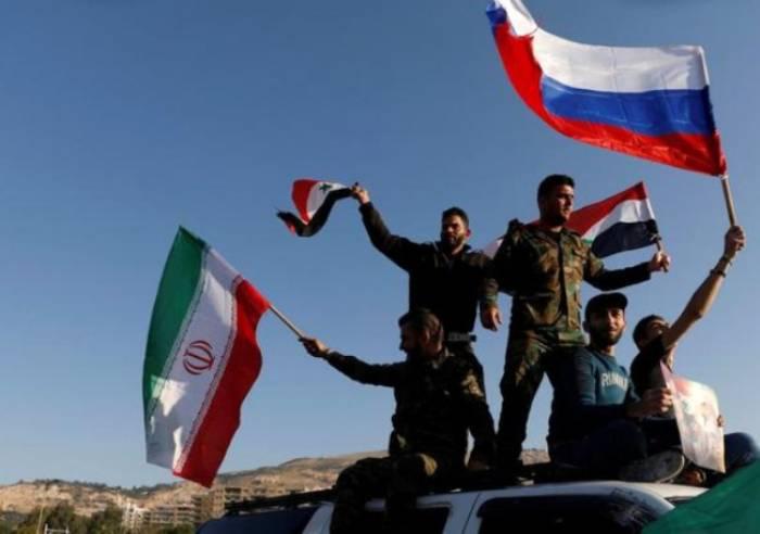 ABŞ vurdu, suriyalılar Rusiya bayraqları qaldırdı - FOTOLAR