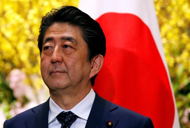 Ex-Japan PM aide denies favor for Abe