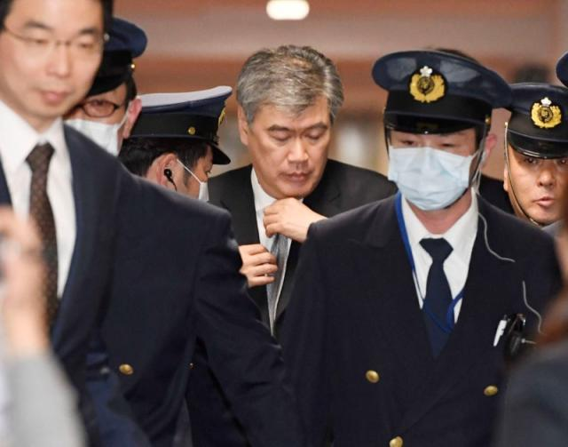 Top Japan finance official denies sexual harassment, says to suepublisher