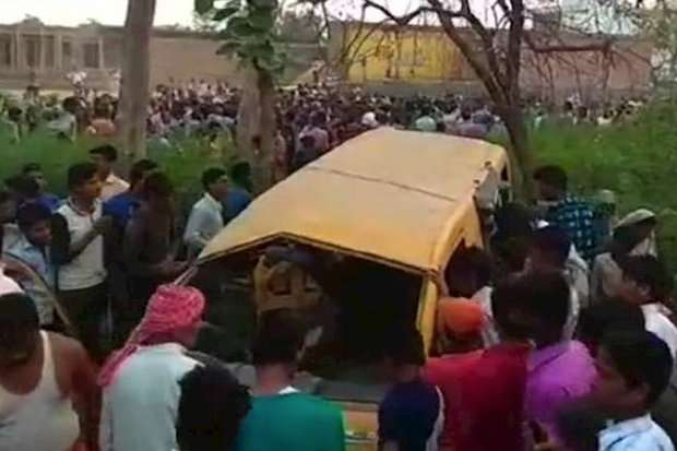 Thirteen children killed when school bus and train collide in northern India