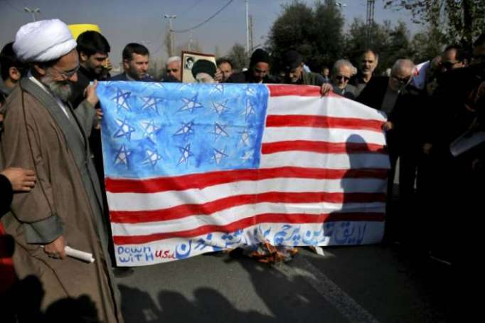 US flag burnt in Iranian parliament