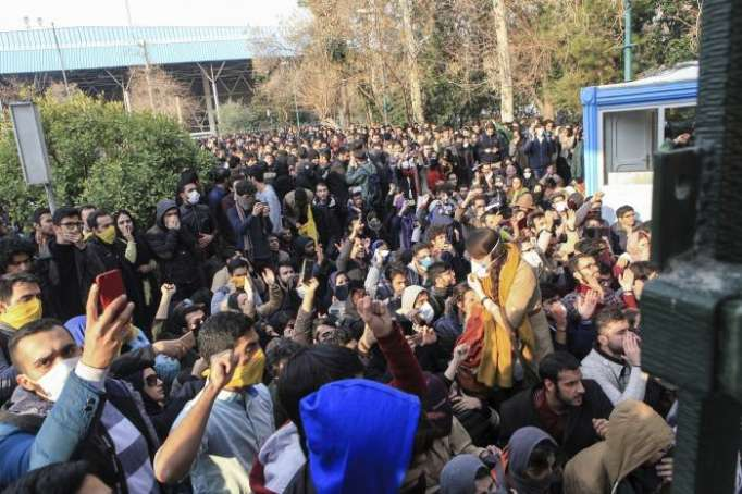 One dead after protesters set fire to police station in southern Iran