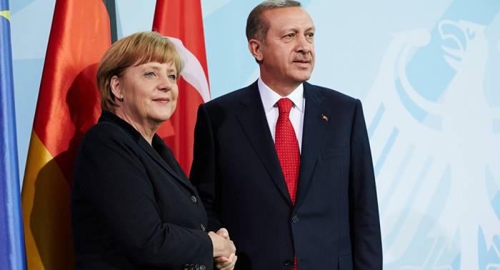 Merkel Ərdoğanı Almaniyaya dəvət edib