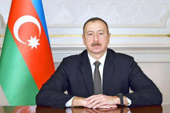 President Ilham Aliyev views international exhibitions in Baku