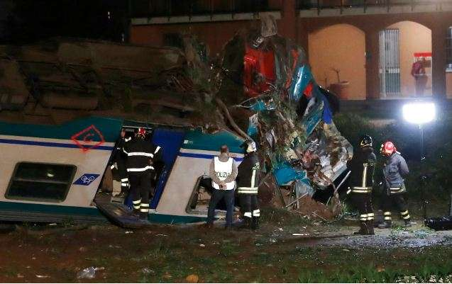 Train derailment at road crossing in Italy kills two and injures 18