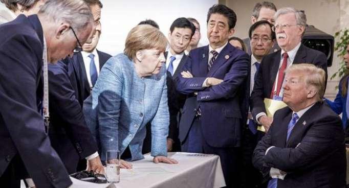 Trump réagit à sa «mauvaise photo» avec Merkel