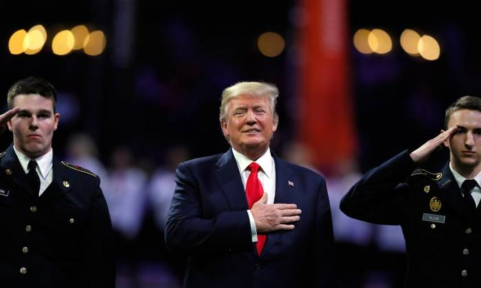 Trump wants 'respect' for the national anthem as he sings half the lyrics - VIDEO