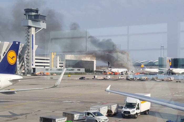 Plane catches fire at Frankfurt Airport after towing truck burst into flames