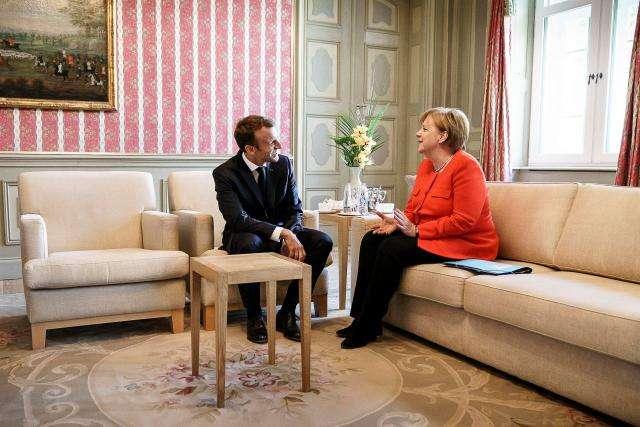 Merkel, Macron back euro zone budget in