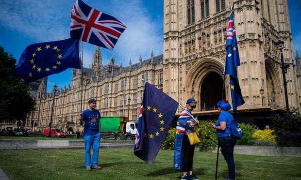 May escapes Brexit bill defeat as Tory rebels accept concessions