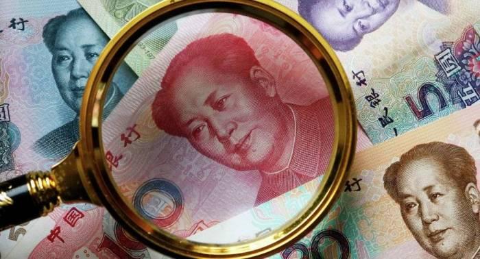 """البنك المركزي الصيني يخفض قيمة صرف"""" اليوان """"مقابل الدولار بنسبة0.7 بالمئة"""