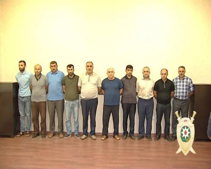 Azerbaijan jails 7 people for sale of pirated teaching aids