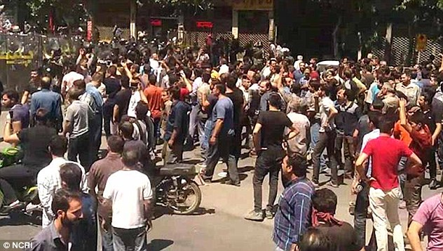 Violence on streets of Iran as police use tear gas on protesters
