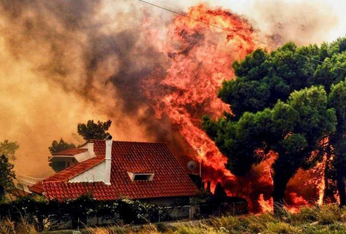 Death toll from Greece's fire disaster rose to 94