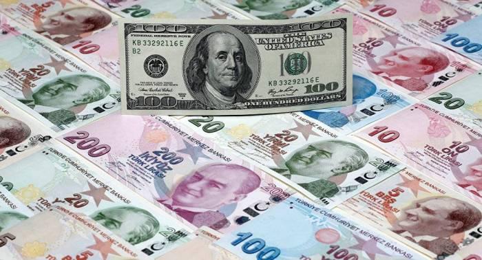 العملة التركية تنخفض وأمريكا تحذر من عقوبات جديدة
