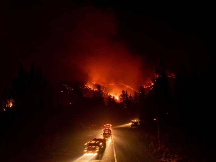 California wildfire nears interstate highway as families flee blaze