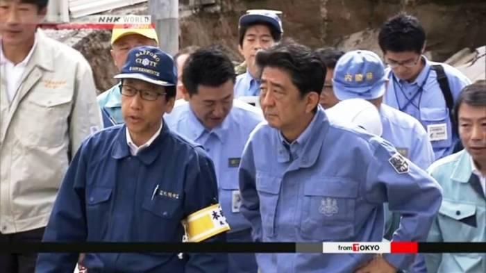Japan PM Abe visits quake-hit Hokkaido as death toll rises to 37