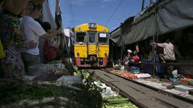 Watch a train run through Thailand