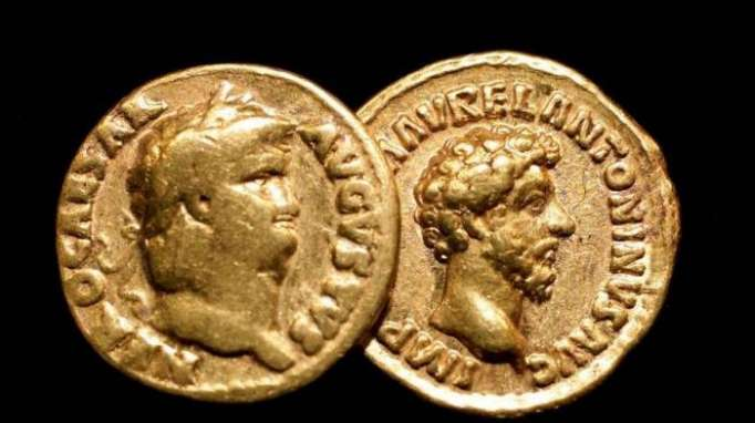 Caesar's gift: Hoard of shiny Roman coins discovered in Italy