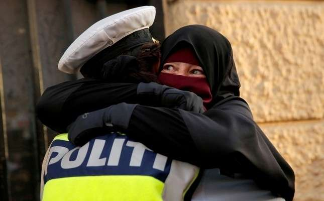 Danish police investigate officer who hugged niqab-wearing protester