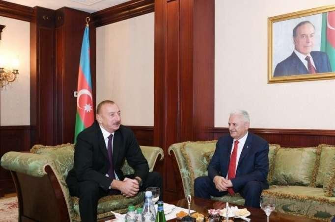 الرئيس إلهام علييف يجتمع برئيس البرلمان التركي