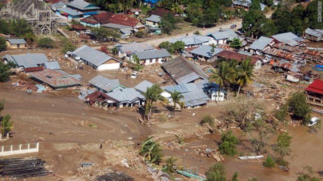 Indonesia flash floods, landslides kill at least 21, destroy hundreds of homes