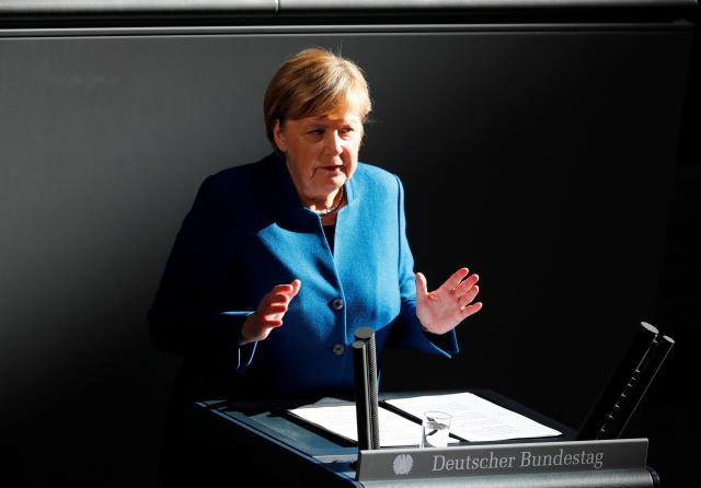 Merkel calls for stable euro zone budgets in warning shot toItaly