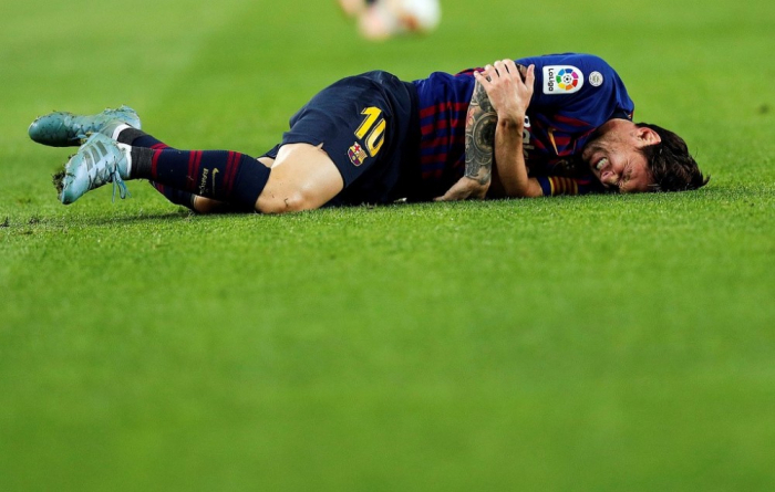 Messi to miss Clasico with fractured arm