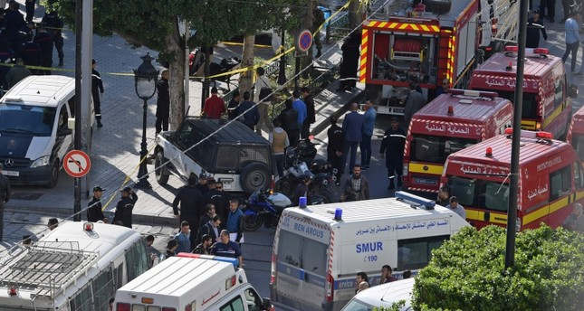Suicide bomber blows herself up in central Tunis, wounds 9 people