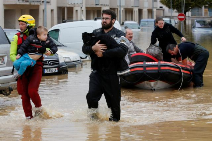 At least 13 killed by flash floods in southern France