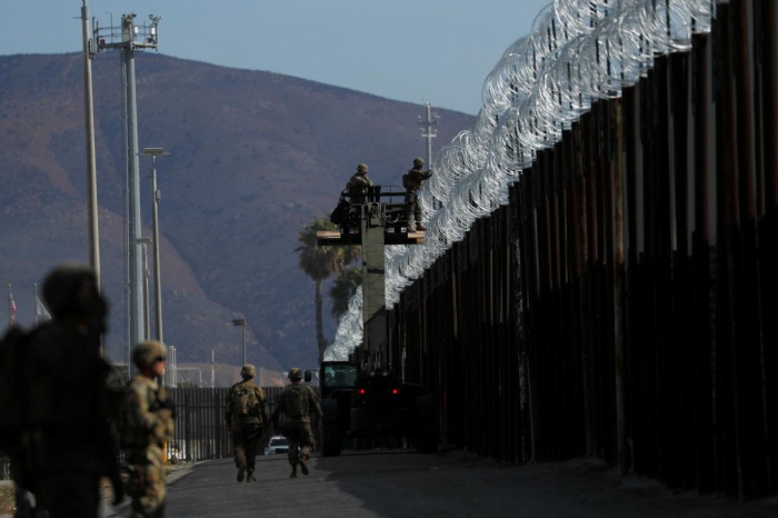 Commander says U.S. military does not view Central American migrants as