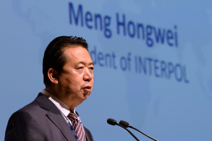 Ex-Interpol chief facing corruption charges is expelled from Chinese government advisory body