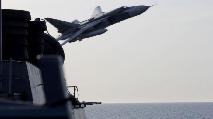 U.S. military air crash off Japan coast kills one Marine, five missing