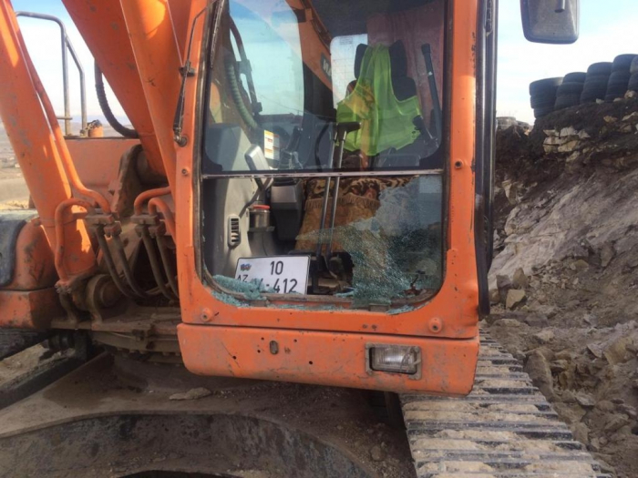 Armenian armed forces again fire on excavator on Azerbaijani side