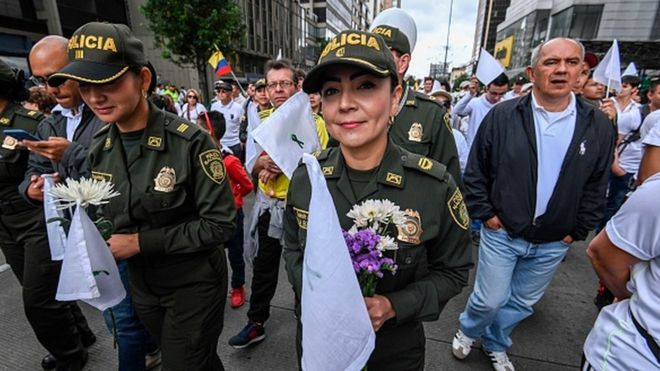 Colombia protest: Thousands march for peace after cadet killings