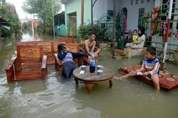 Indonesia death toll from floods, landslides climbs to 68